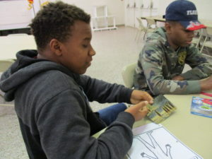 youth doing an activity around a table