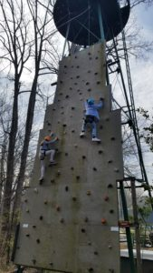 youth doing a wall climb activity